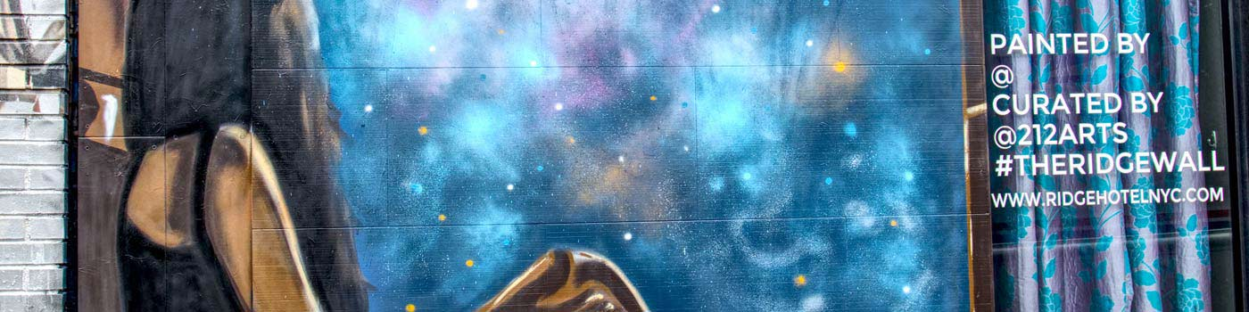 wall mural of a young woman staring at stars in the night sky