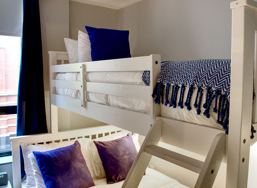Bunkbeds with purple pillows